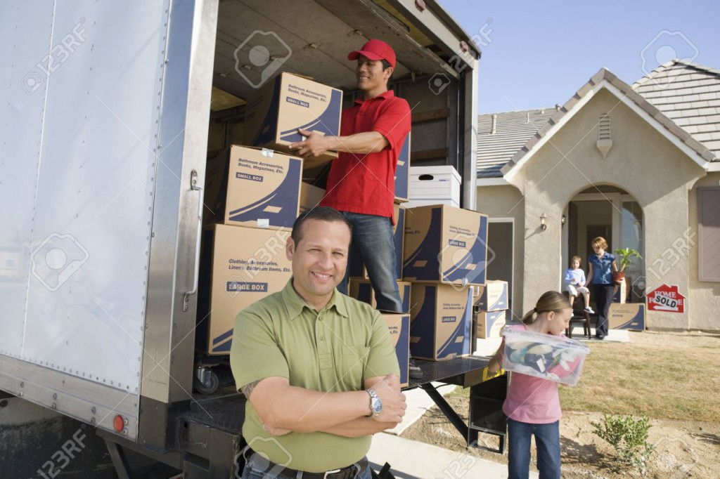 18833843-Family-and-worker-unloading-truck-of-cardboard-boxes-Stock-Photo